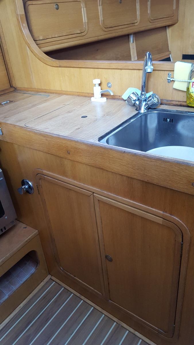 Galley storage below sinks